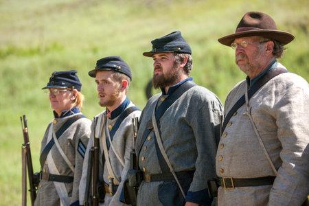 reenact: Confederate reenactors in formation  Medical Lake, Washington USA - May 24, 2014  Civil war reenactment of Deep creek battle near Medical Lake, Washington on May 24, 2014