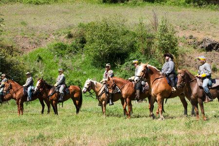 reenact: Confederate reenactors on horseback  Medical Lake, Washington USA - May 24, 2014  Civil war reenactment of Deep creek battle near Medical Lake, Washington on May 24, 2014