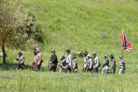 Confederate reenactors on the march  Medical Lake, Washington USA - May 24, 2014  Civil war reenactment of Deep creek battle near Medical Lake, Washington on May 24, 2014