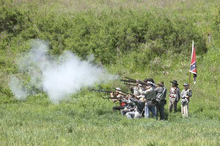 Confederate reenactors shooting their rifles  Medical Lake, Washington USA - May 24, 2014  Civil war reenactment of Deep creek battle near Medical Lake, Washington on May 24, 2014  Editorial