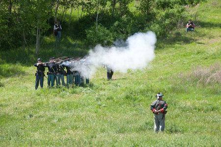 reenact: Union army reenactors in mock battle  Medical Lake, Washington USA - May 24, 2014  Civil war reenactment of Deep creek battle near Medical Lake, Washington on May 24, 2014