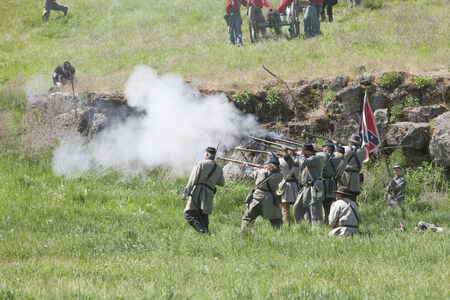 Confederate army reenactors in mock battle  Medical Lake, Washington USA - May 24, 2014  Civil war reenactment of Deep creek battle near Medical Lake, Washington on May 24, 2014