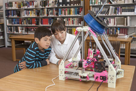 3d: Kids learn about the 3D printer  Stock Photo