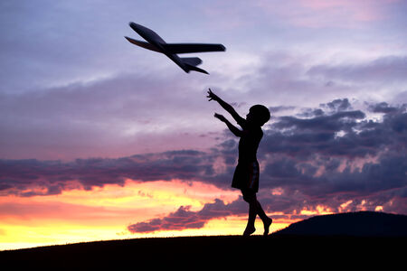 pursue: Boy flies a toy plane