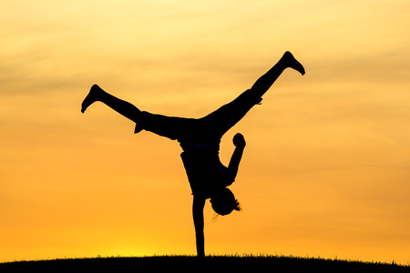 handed: One handed cartwheel   Stock Photo
