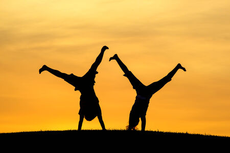 liveliness: Doing cartwheels together   Stock Photo