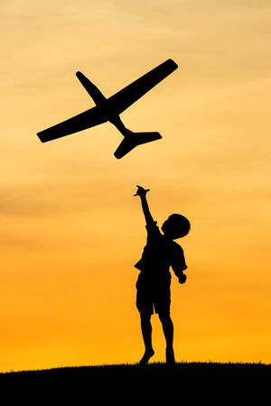 Boy launches toy plane  Stock Photo