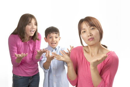 nagging: Kids nagging mom  Stock Photo