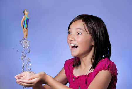 imaginative: Concept of girl diving from hands  Stock Photo
