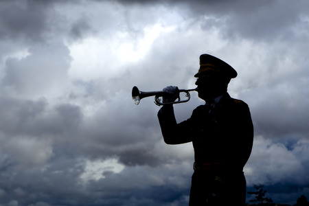 Silhouette of bugle player. photo