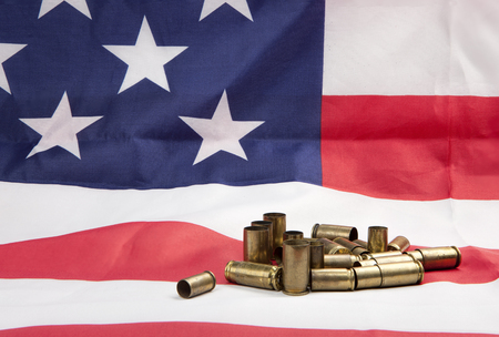 casings: Pile of spent casings on the flag. Stock Photo