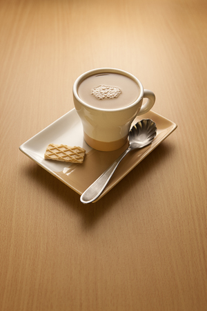 capuccino: Capuccino and a wafer. Stock Photo