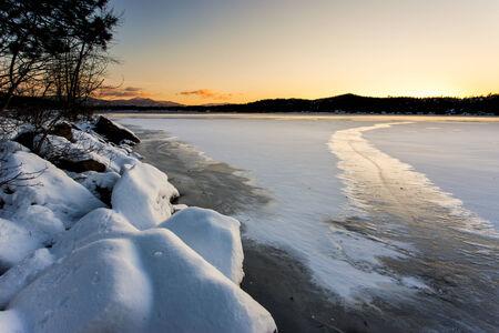 frozen lake: Frozen Lake at sunset. Stock Photo