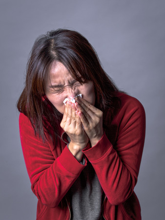 A woman with a cold blows her nose way too hard.