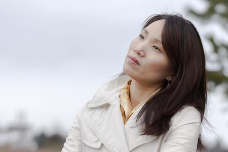 enjoys: Korean woman enjoys the weather.