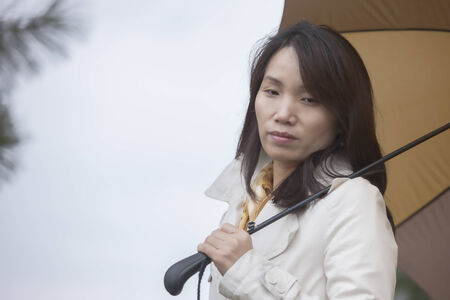 lost in thought: Korean woman lost in thought.