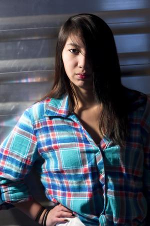 side lighting: Side lighting on young woman.