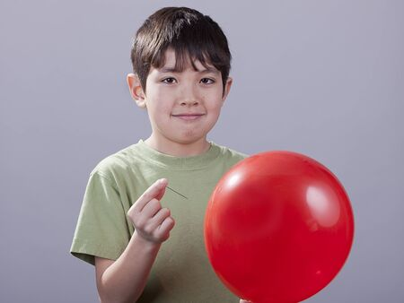 Boy with pin and ballloon. Stock Photo