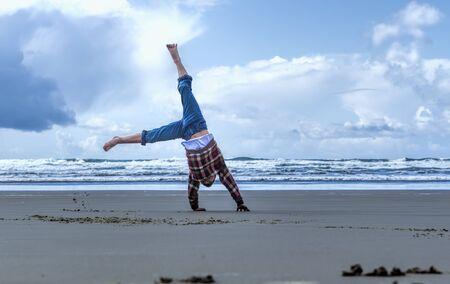 Cartwheel on the beach in Newport, Oregon. photo