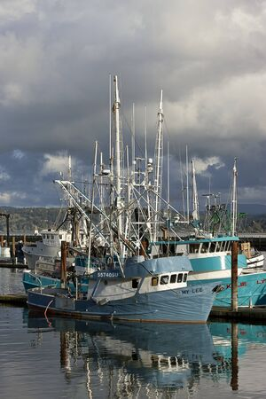 famous industries: Close up of fishing vessel at the historic bay front in Newport, Oregon.