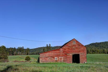 tensed: Barn in green field south of Tensed Idaho. Stock Photo