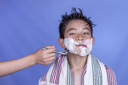 make believe: Pretend shaving and a funny look.
