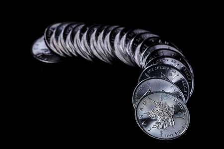 silver coins: Line of silver coins.