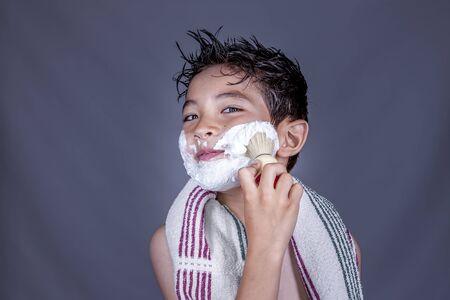 make believe: Having fun with shaving cream.