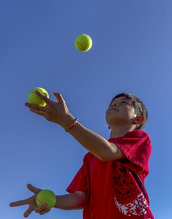 Boy tries juggling.