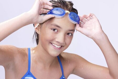athletic wear: Raising her goggles.