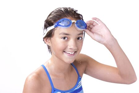 athletic wear: Young swimmer holds her goggles.