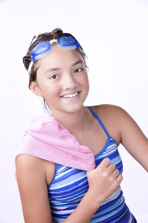 athletic wear: ASwimmer with towel over shoulder.