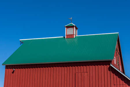 red barn: Red barn, green roof, blue sky,