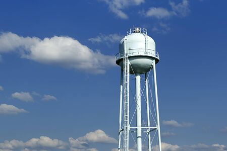 water tower: Water tower against blue sky.