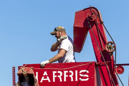davenport: An editorial image of a garmer in a combine during the Davenport, Washington vintage harvest.