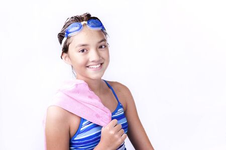 over the shoulder: Young teen with towel over shoulder.