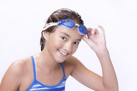 athletic wear: Young teen lifts goggles.