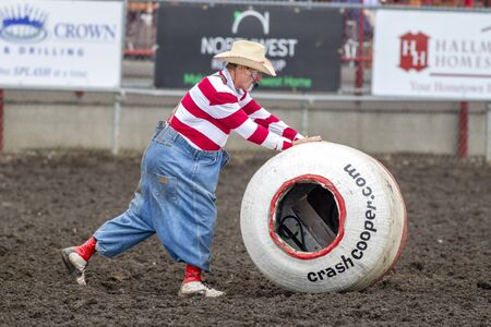 pushes: Rodeo clown pushes barrel at the north Idaho Fair on August 30, 2015. Editorial