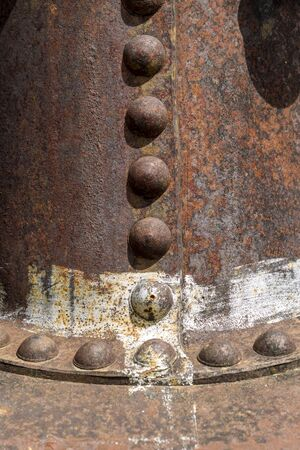 Rusted pipes and rivets.