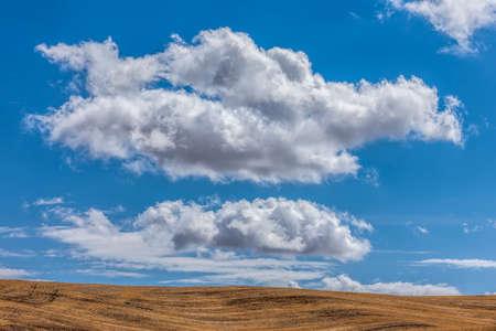 Shaped clouds above the land near Colfax, Washington. Stock Photo