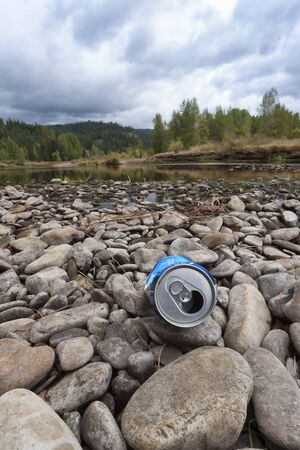 Litter on the river bed in north Idaho. 写真素材