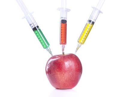 apple gmo: GMO concept of three needles in apple.