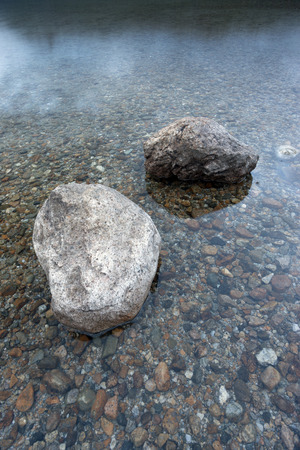 boulders: Closeup of boulders in shallow water.