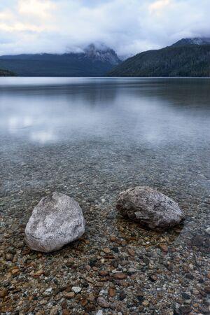 redfish: Two boulders in Redfish Lake in Idaho. Stock Photo