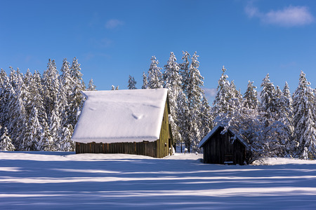 farm structures: Snow layered on barns roof north of Hayden, Idaho.