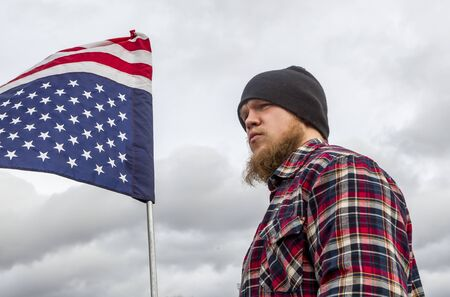 held down: A man holds an upside down flag at a rally for Lavoy Finicum being held in Coeur dAlene, Idaho on February 6, 2016.
