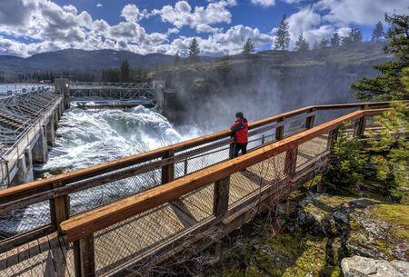 post: Woman on walkway at the Dam in Post Falls, Idaho.