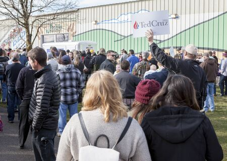 senator: Signs being held up at a Ted Cruz Rally amongst all of the supporters waiting outside in Coeur dAlene, Idaho on March 5, 2016.