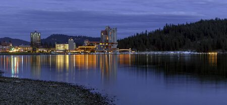 The panoramic view of downtown Coeur d'Alene early in the evening from the beach area. Stok Fotoğraf