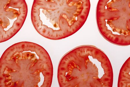 tomato slices: Tomato slices on white background.